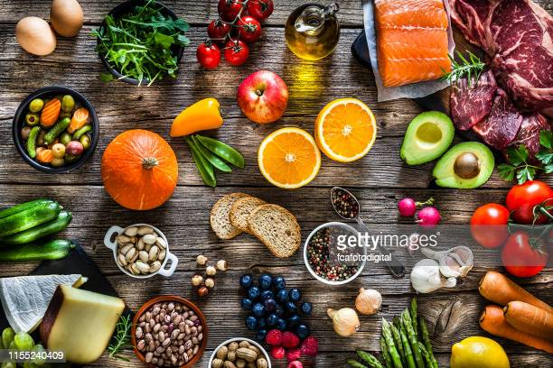 food backgrounds: table filled with large variety of food - alimentação saudável imagens e fotografias de stock