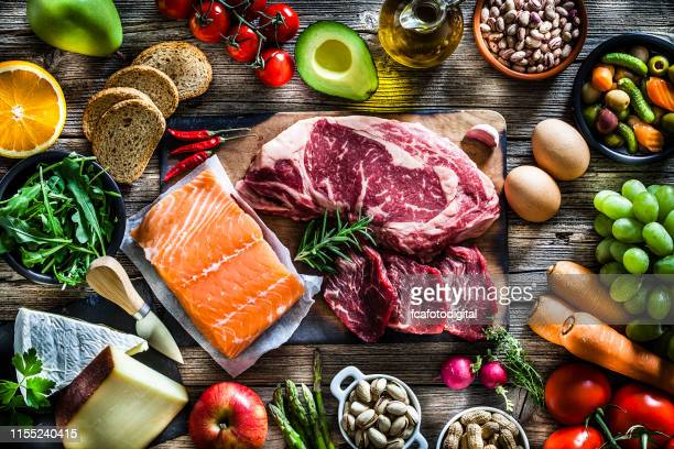 food backgrounds: table filled with large variety of food - food pyramid stock pictures, royalty-free photos & images