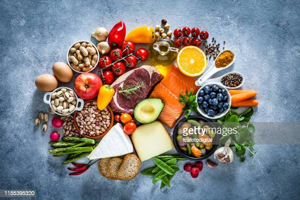 food backgrounds: table filled with large variety of food - food state stock pictures, royalty-free photos & images