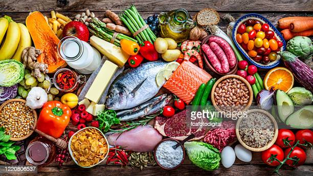 food backgrounds: table filled with large variety of food shot from above - healthy eating stock pictures, royalty-free photos & images