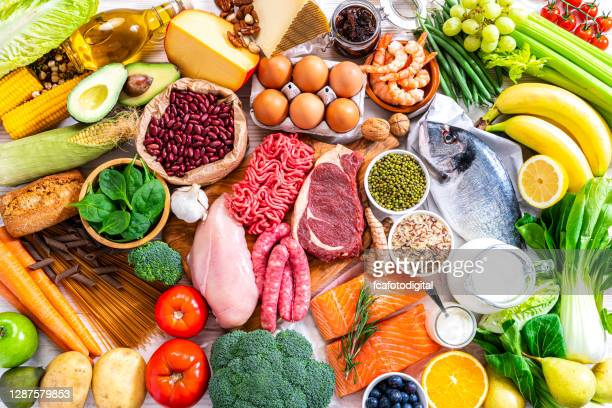 food backgrounds: table filled with large variety of food shot from above - food pyramid stock pictures, royalty-free photos & images