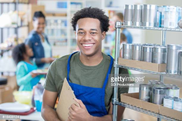 Food bank manager organizes the inventory