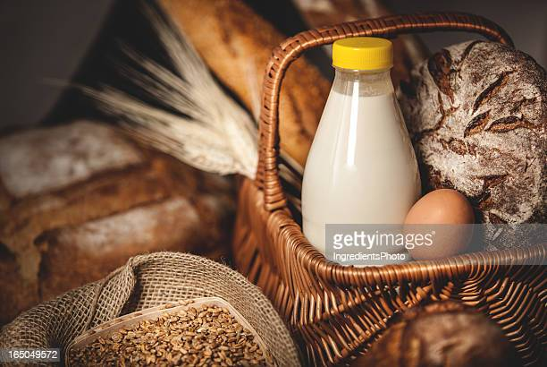 Food basket dairy products, bread and eggs.