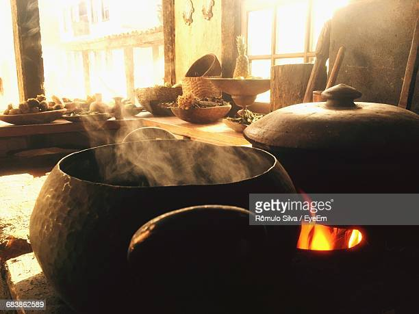 Food Being Cooked On Wood Burning Stove In Kitchen