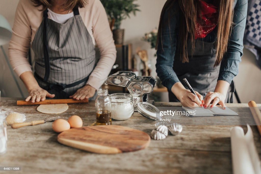 Food bloger writing down recipe in notebook stock photo getty images food bloger writing down recipe in notebook stock photo forumfinder Image collections