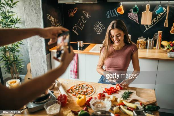 food blogger photographing food preparation - blogging stock pictures, royalty-free photos & images