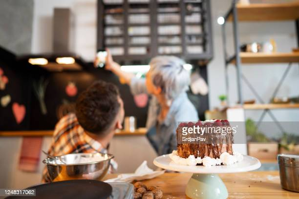 food bloggers - women whipping men stock pictures, royalty-free photos & images