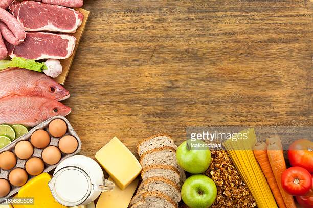 Food border on rustic wood table shot from above