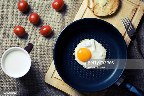 food breakfast egg milk - fried eggs stock pictures, royalty-free photos & images