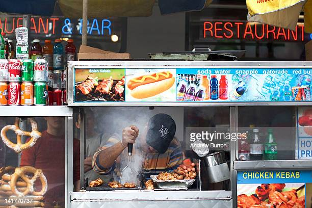 A food cart vendor cooks food in Times Square on March 23 2012 in New York City A recent study found that the Times Square district contributes up to...