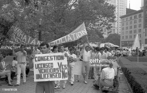 Food cart vendors march to protest against mayoral regulation in City Hall Park in downtown Manhattan New York New York August 21 1988 One holds a...