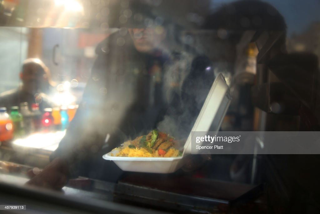 A food cart worker fills a styrofoam take-out container with food for a customer on December 19, 2013 in New York City. New York's City Council will vote Thursday on a bill that would see expanded polystyrene (EPS), or styrofoam, either banned or added to the city's curbside recycling program. The current version of the bill would give the city's sanitation commissioner until Jan. 1, 2015 to decide whether plastic foam is recyclable. The proposed ban has been met with resistance from the American Chemistry Council and Dart Container among other groups.