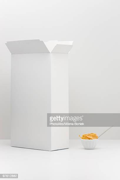 Food concept, cereal box with small bowl of cereal