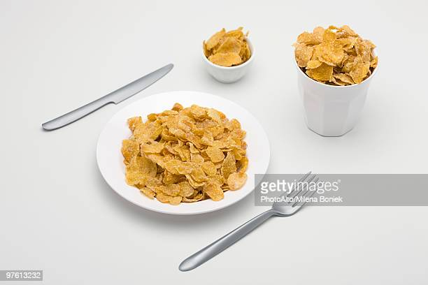 Food concept, cereal filling plate, bowl and glass