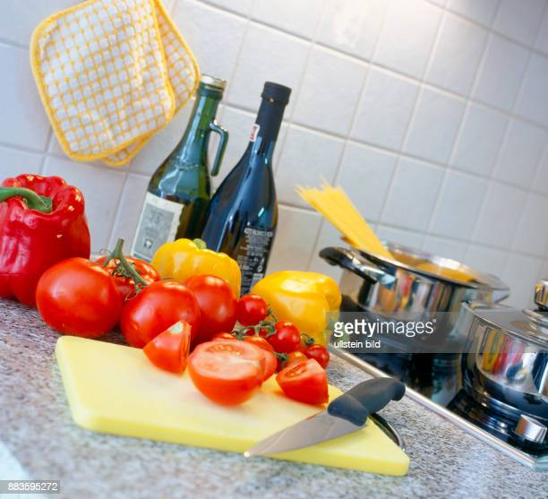 Food Cooking kitchen tomatoes yellow and red peppers pasta olive oil