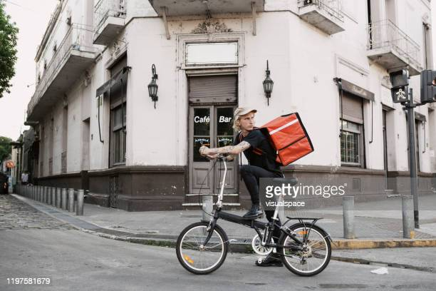 food courier in the city - bicycle messenger stock pictures, royalty-free photos & images