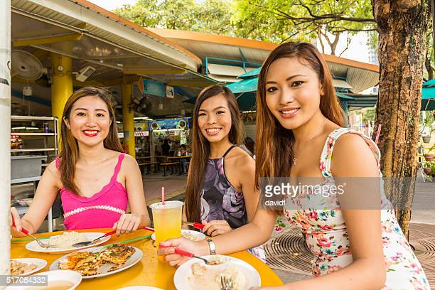 Food Court Meal for Happy Young Women in Singapore