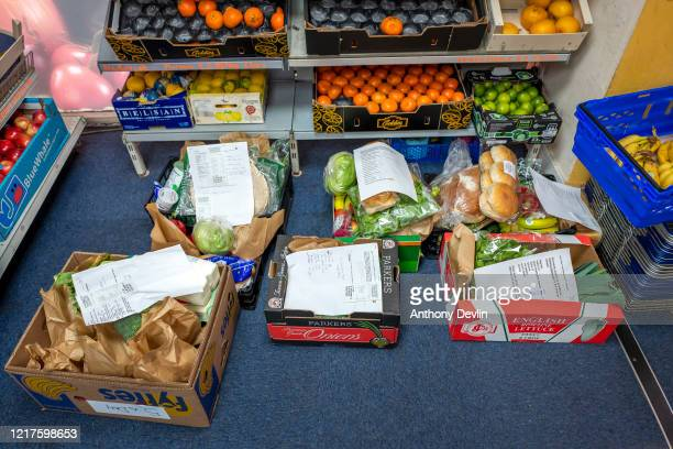 Food deliveries wait to be collected as staff at 5ADay greengrocers prepare food boxes for vulnerable and self isolating customers in Stalybridge on...