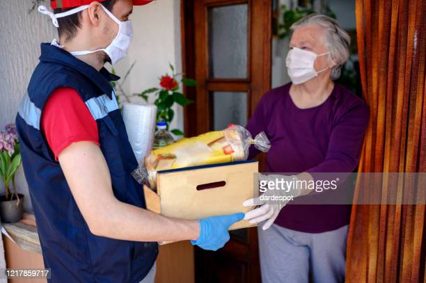 food delivering at home address - essential workers stock pictures, royalty-free photos & images