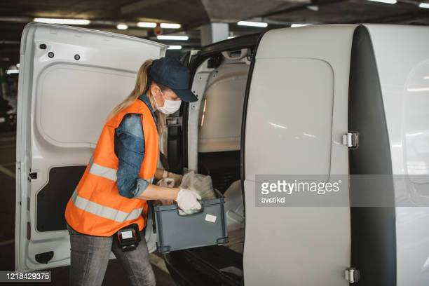food delivering car unloading - surgical glove stock pictures, royalty-free photos & images