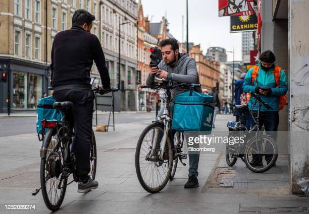 Food delivery couriers for Deliveroo Holdings Plc and Just Eat Takeaway.com NV collect orders from a KFC restaurant in London, U.K., on Wednesday,...