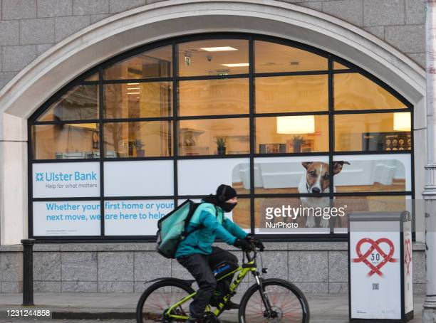 Food delivery curier cycles by the Ulster Bank buildings on Georges Quay in Dublincity center during Level 5 COVID-19 lockdown. Tomorrow, Friday 19...