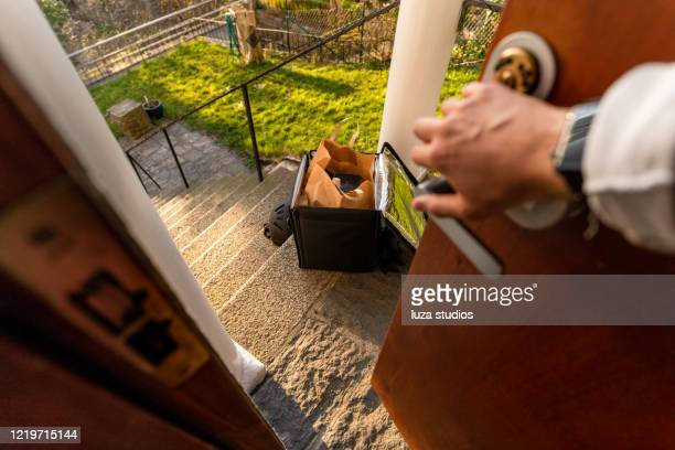 food delivery in front of the house - open backpack stock pictures, royalty-free photos & images
