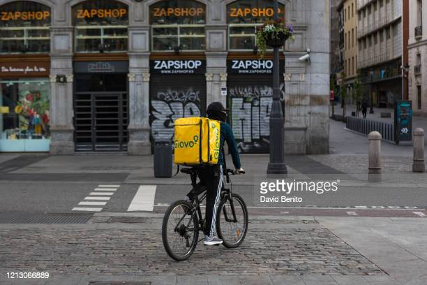 A food delivery man is seen circulating at Sol Square in Madrid on the second working day of the state of alarm on March 17 2020 in Madrid SpainThe...
