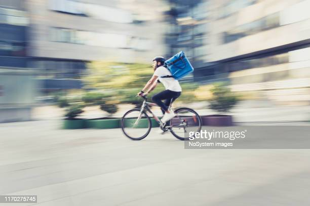 food delivery on bicycle - delivery person stock pictures, royalty-free photos & images