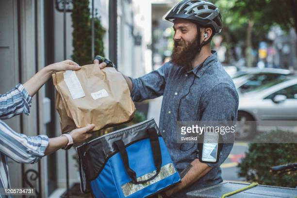 food delivery - food distribution stock pictures, royalty-free photos & images