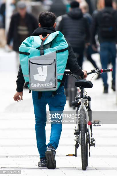 A food delivery rider on March 11 2020 in Cardiff United Kingdom Food delivery services have reported a surge in sales as consumers opt to stay in...