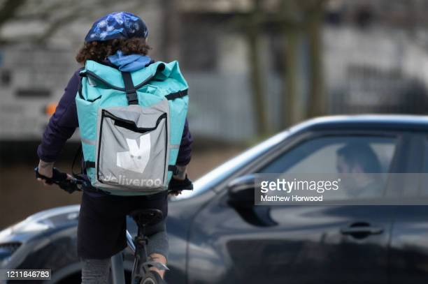 A food delivery rider on March 8 2020 in Cardiff United Kingdom Food delivery services have reported a surge in sales as consumers opt to stay in...