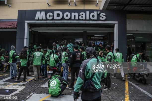 Food delivery riders make their way into a McDonalds outlet in Bogor on June 9 to buy the new BTS-meal deal for hungry fans in the K-Pop mad country,...