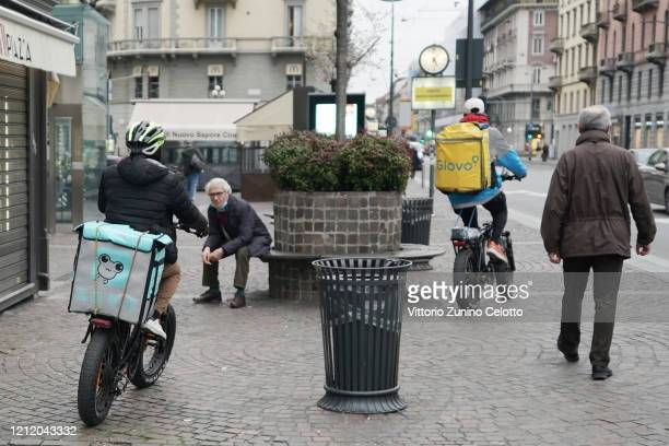 Food delivery riders on March 12, 2020 in Milan, Italy. The Italian Government has strengthened up its quarantine rules, shutting all commercial...