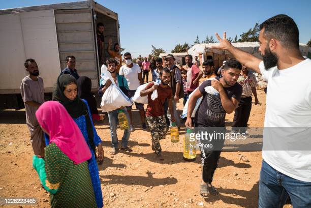 Food distribution in Syrian refugee from Uk charity Proactive Support in informal settlements in Makni refugee camp on August 21 2020 , Lebanon