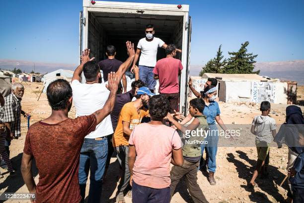 Food distribution in Syrian refugee from Uk charity Proactive Support in informal settlements in Makni refugee camp on August 21 Lebanon