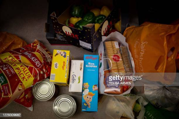 Food donations for vulnerable families are pictured at the Cooking Champions food bank in Grange Park, north London on October 27 during the novel...