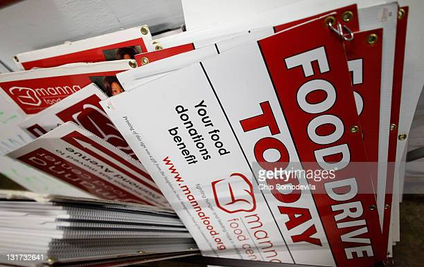 Food drive signs are stacked at the Manna Food Center which distributed about 172000 70pound packages of food to needy families during FY 2011...