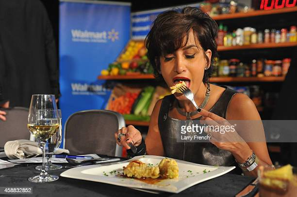 Food expert blogger Alli Guleria degustates a potato chips dish brought by Duff Goldman during the DC Central Kitchen's Capital Food Fight event at...