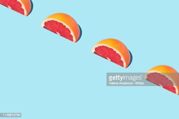 food fashion food pattern with grapefruits - man made object stock pictures, royalty-free photos & images