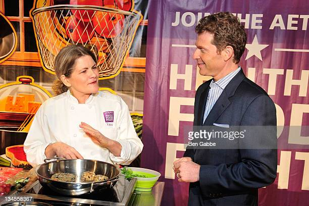 Food Fight winner Merry Graham and Bobby Flay attend the Aetna Healthy Food Fight regional semifinal cookoff at ABC Studios on December 2 2011 in New...