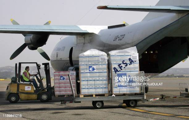 Food for starving children of Maradi, Niger, is loaded into an Antonov 12 on July 29 at the Marseille Marignane Airport, southern France, a...
