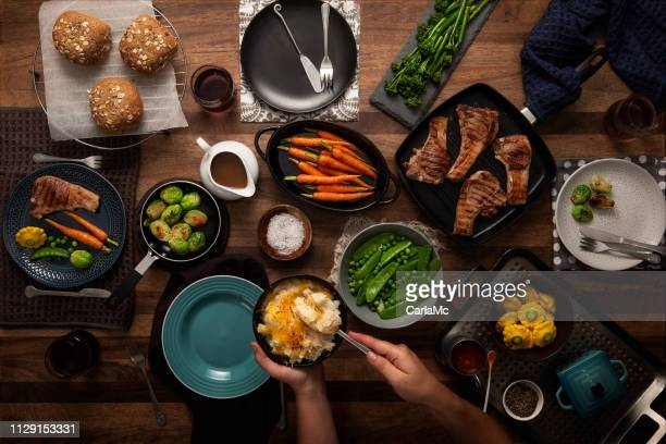 food for the family - dinner table stock pictures, royalty-free photos & images