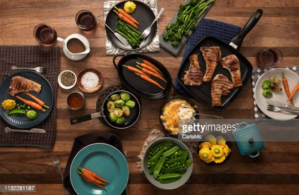food for the family - dining table stock pictures, royalty-free photos & images