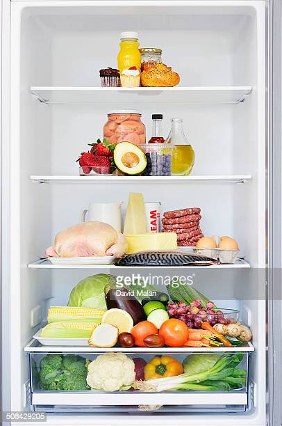 food forming a food pyramid in a fridge - food pyramid stock pictures, royalty-free photos & images