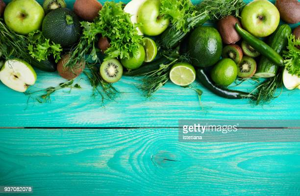 food frame  with fresh green fruits and vegetables - harvest table stock pictures, royalty-free photos & images