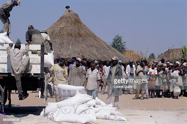Food from the World Food Program arrives in a refugee camp in Kuito Angola After Angola gained independence from Portugal in 1975 civil war erupted...