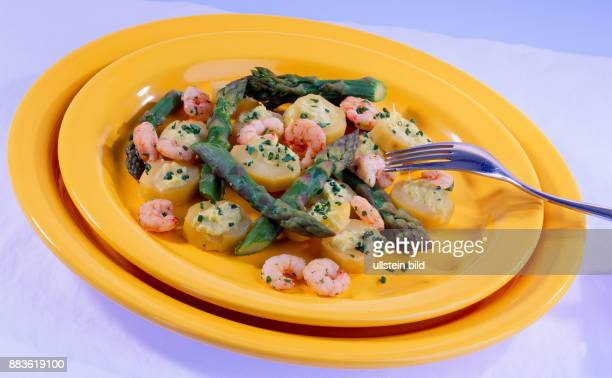 Food green asparagus with potatoes and shrimps