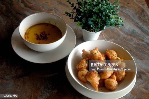 food in bowls on plates over table - san stock pictures, royalty-free photos & images