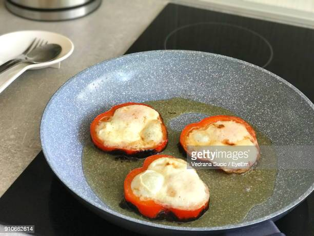 Food In Frying Pan On Stove
